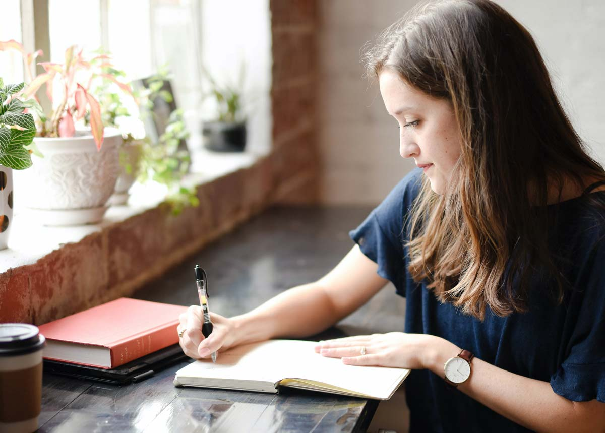 Woman writing in journal - Immunity to Change