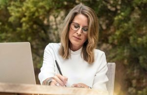 Best Life Coach Certification - Woman on Computer Outside