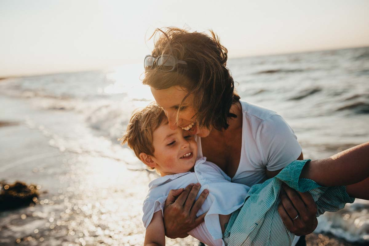 Mother and son on beach - Give yourself permission to be happy