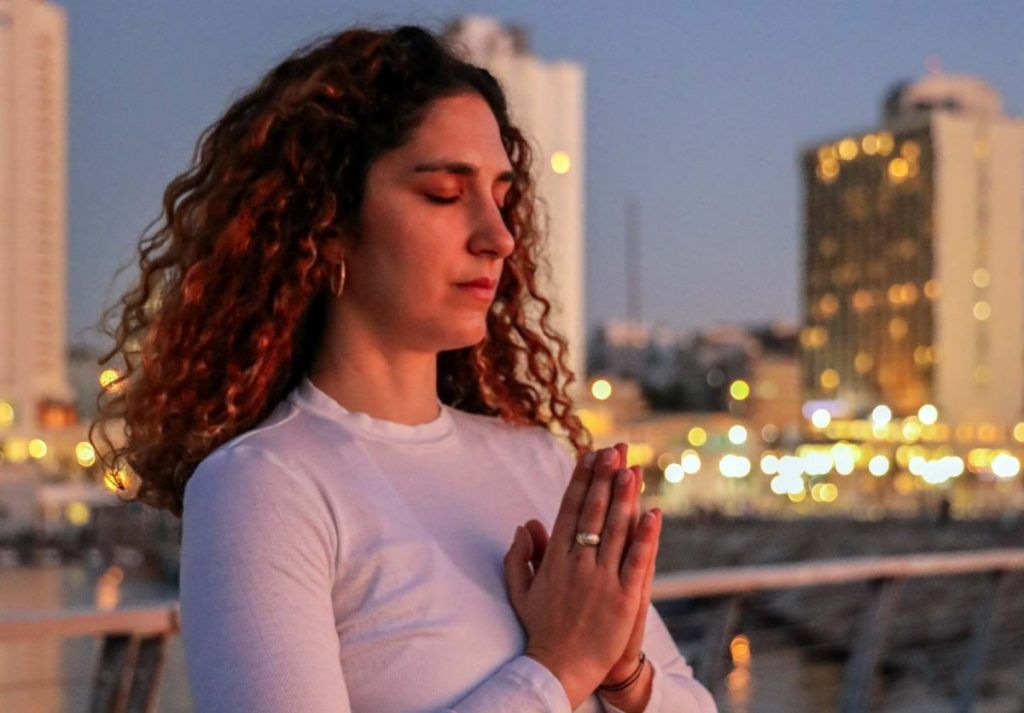 Woman Meditating - Law of Attraction & Life Coaching
